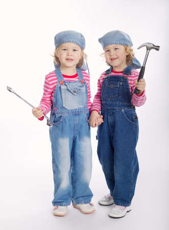 two twin girls are ready to work