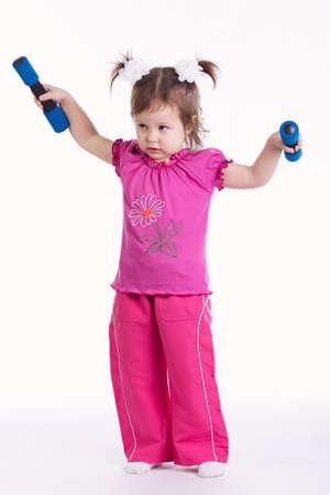 little girl lifting dumbbells Isolated on white background Stock Photo