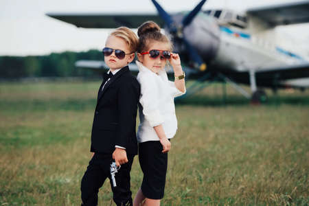 photo of young boy and girl playing spy Stock Photo