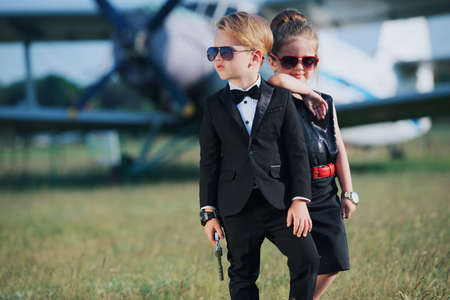 Photo of young boy and girl playing spy Imagens