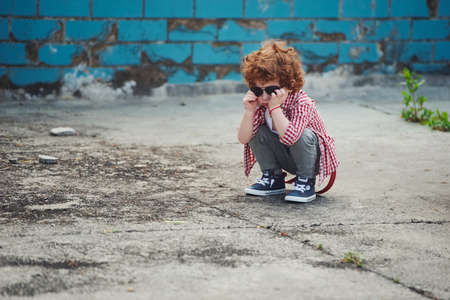 little serious boy with sunglasses Stock Photo