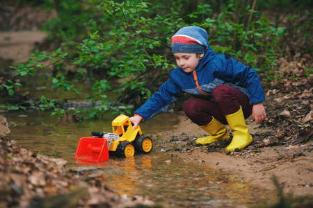 photo of little boy playing with toy truck Stock Photo