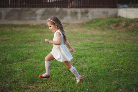 little beautiful running girl outside Stock Photo