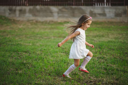 little beautiful running girl outside Stock Photo