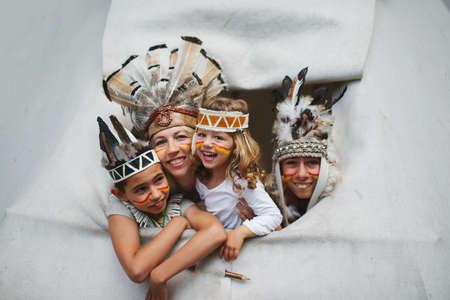 happy children playing native american Stock Photo