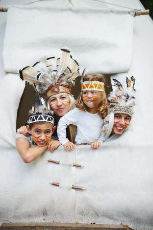 outerwear: happy children playing native american Stock Photo