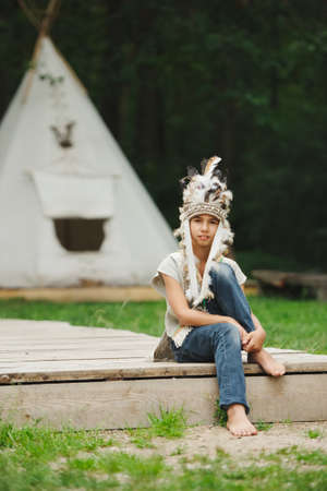 native american baby: little funny boy playing native american Stock Photo