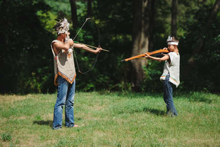 little funny boy playing native american photo
