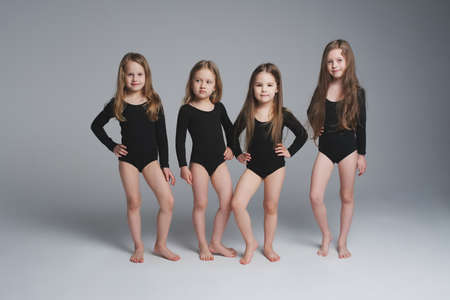 four young beautiful models on grey