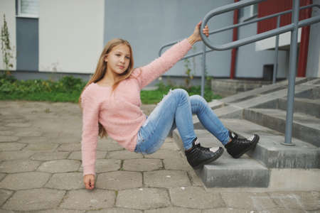 beautiful young girl posing on the street