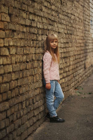 Beautiful young girl posing on the street Stock Photo