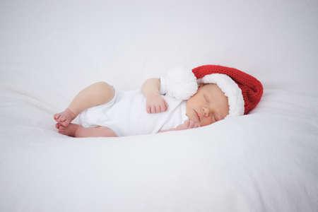 Cute newborn baby with santa hat