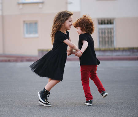 boy and girl dancing on the street Stock Photo