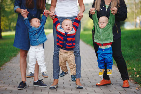 mothers holding sons by hand Stock Photo