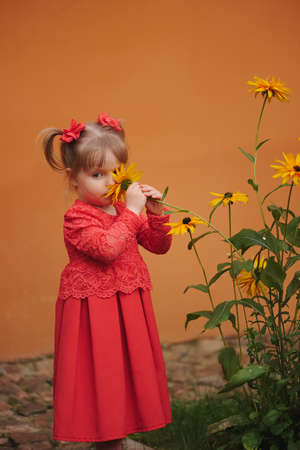 happy little girl with yellow flowers