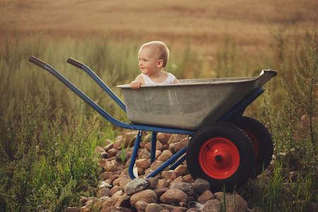 cute little boy with wheelbarrow Stock Photo