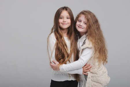 two beautiful girls on white background Stock Photo