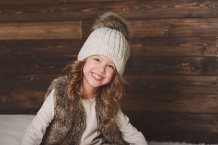 cute little girl with knitted hat Фото со стока