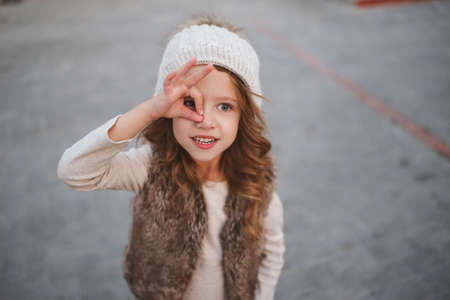 cute little girl with knitted hat Stock Photo