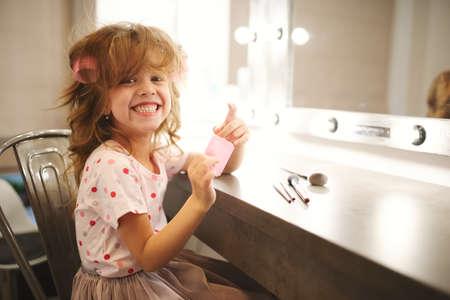cute little girl making make-up