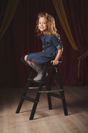 happy girl with theater curtain on background Stock Photo