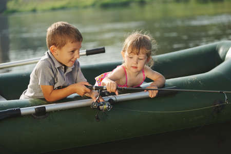 happy boy swimming in fishing boat