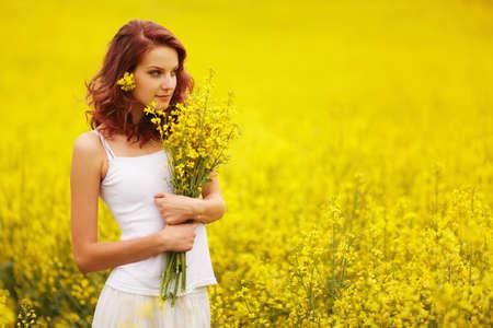 Beautiful girl in the yellow field Reklamní fotografie