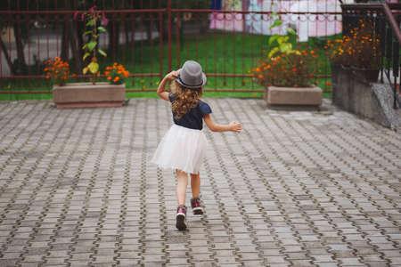 young happy girl running away