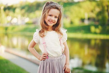 cute little girl in summer park