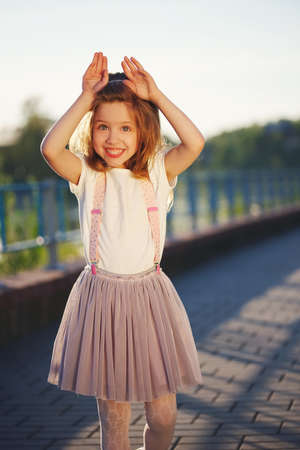 cute little girl in summer park