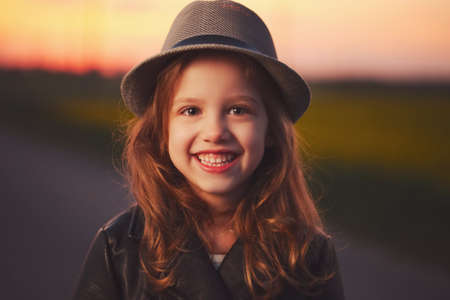 beautiful girl with hat on evening sunset 写真素材