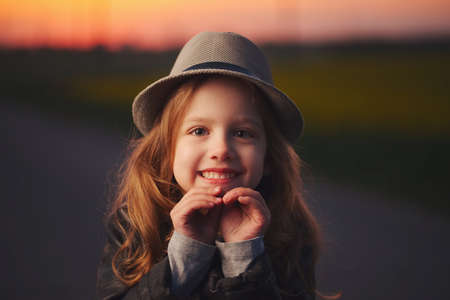 beautiful girl with hat on evening sunset Reklamní fotografie