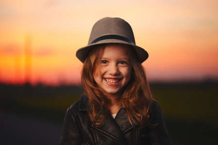 beautiful girl with hat on evening sunset Stok Fotoğraf
