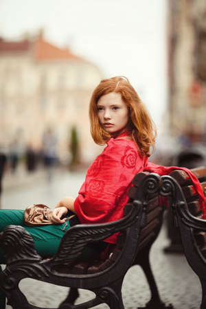 young beautiful girl on bench