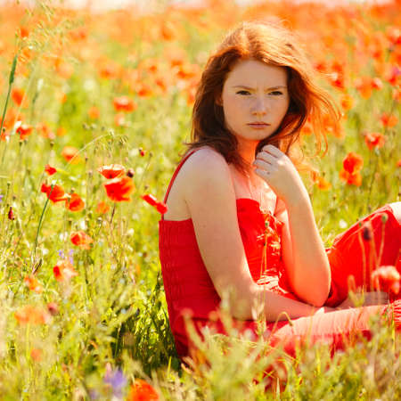 beautiful girl in poppy field Reklamní fotografie