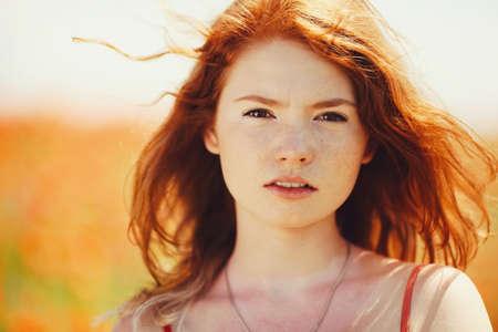 beautiful girl in poppy field Stock fotó