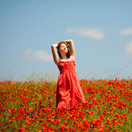 young girl in poppy field