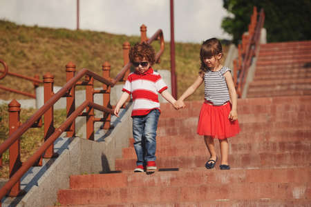little boy and girl on stairway Banque d'images