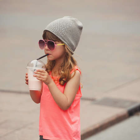 little hipster girl with coctail