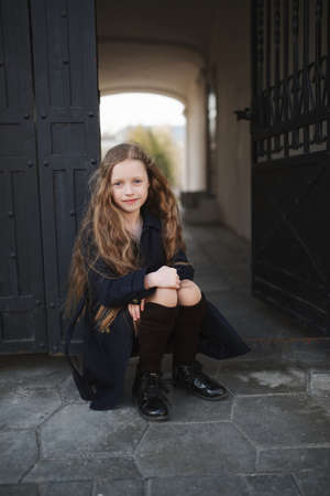 portrait of young girl in black coat