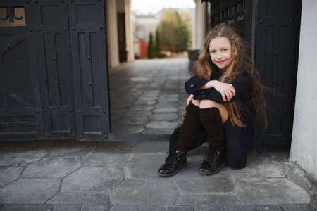 portrait of young girl in black coat