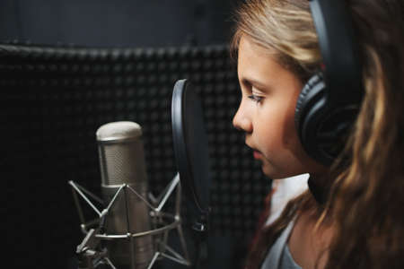 little girl singing in recording studio