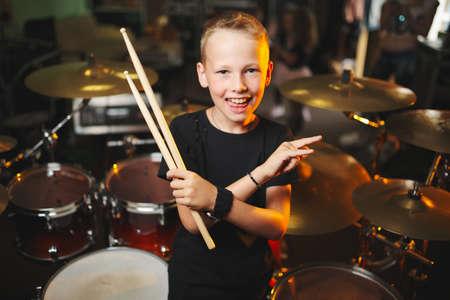 boy plays drums in recording studio Stock Photo