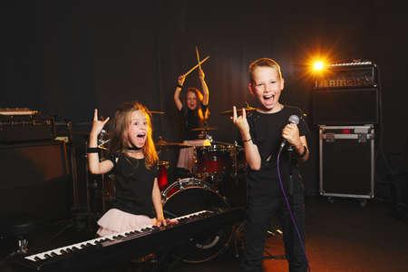children singing and playing music 写真素材