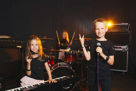 children singing and playing music Foto de archivo