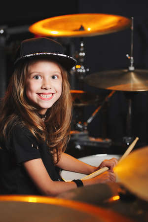 boy plays drums in recording studio Stock Photo