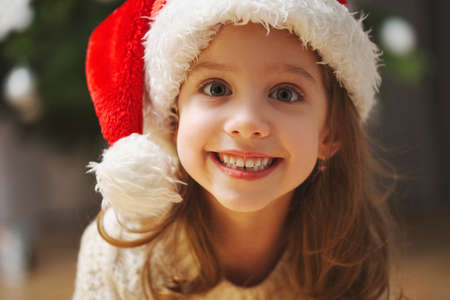 little beautiful girl with red santa hat