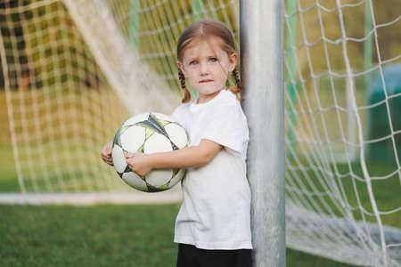 little happy girl on football field Stok Fotoğraf