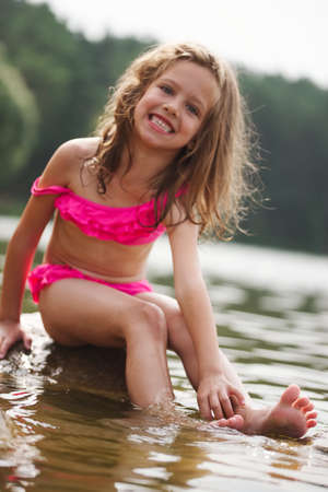 cute happy little girls in sumer lake Stockfoto