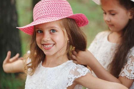 girl braids her friends braid in park